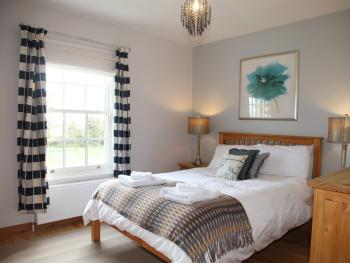 Old Post Cottage main bedroom with view across the village green