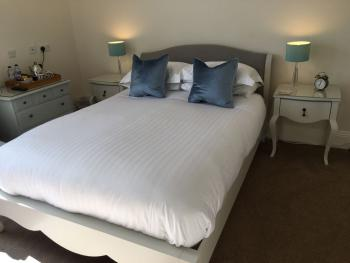 Comfy king sized bed with lovely sea views to enjoy.
