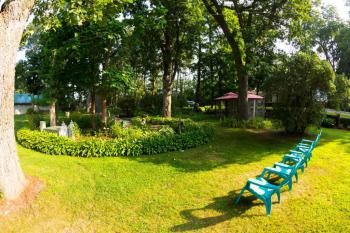 Sitting enjoying the natural sunshine is a suitable activity.  Area in backyard under the aged Bur Oak trees.