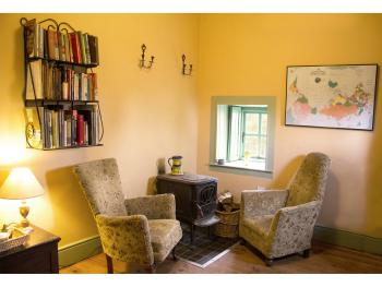 The Sitting Room in the Writer's Cottage with pot-belly wood stove