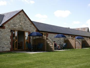 Rear view of the cottages showing cottages garden & individual screened patios