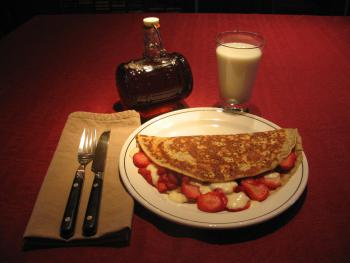 Breakfast at the B&B, crêpe filled with fresh strawberries