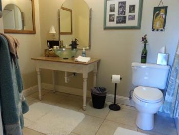 The Dog Patch Bathroom with a floor to ceiling tile shower.