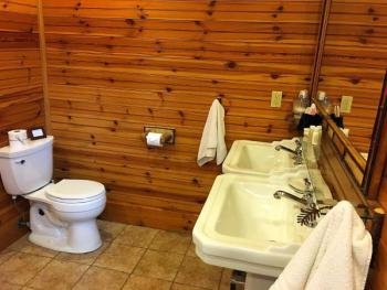"""Birch"" bathroom with dual pedestal sinks"