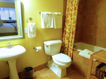 Cypress Room ensuite private bathroom with jacuzzi tub/shower