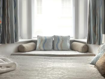 Lovely room with comfy king sized bed and window seat with view out to sea