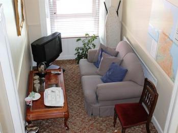 First floor coffee/tea area & television.