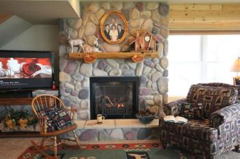 beautiful stone fireplace and comfortable chairs