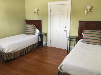 The Smith Room of the Dashiell-Smith two bedroom suite features two twins, perfect for children of friends on a getaway and is located on the second level of the Garden House.