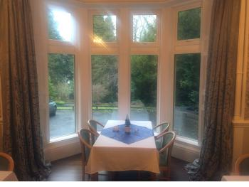 Breakfast is served in the 30 seat dining room with large bay window overlooking the private grounds