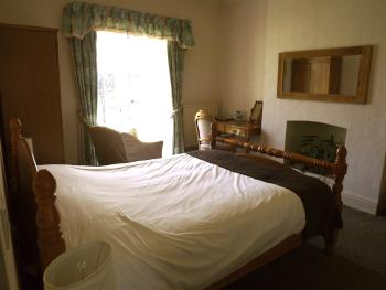 Double room, ensuite with doors to the garden and sea view