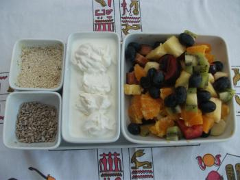 Fresh fruit salad is prepared daily and is served with low fat yoghurt & a variety of seeds