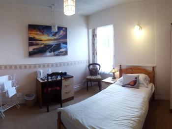 Single room en-suite with sea views. 3rd Floor