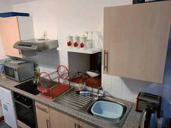 Fully equipped kitchen with appliances and utensils. Large, additional Fridge Freezer is located in the boathouse