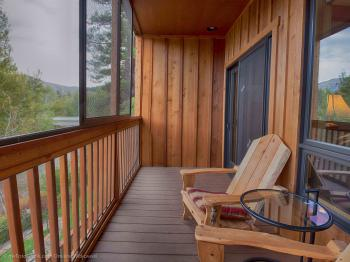 Private screened-in porch overlooking the river