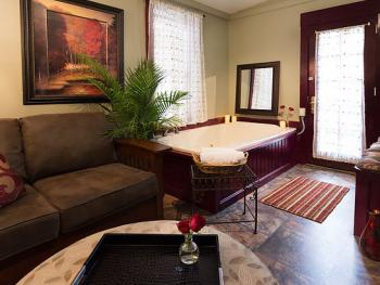 The luxurious Suite has a jetted tub, a kitchenette, and an outdoor sitting area overlooking the creek.