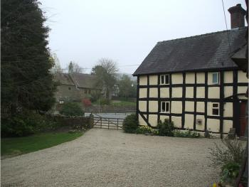 Brick House Farm - View of house and village church