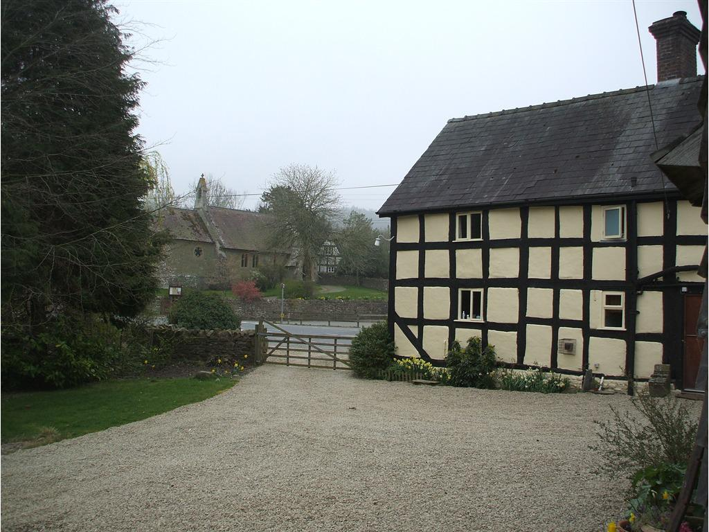 View of house and village church