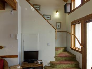 TV and Stairs to loft
