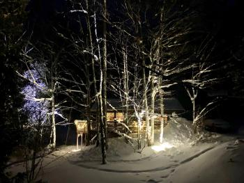 View of cabin at night in the winter