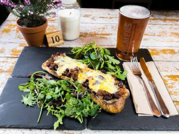 """A Hearty """"Shoe"""" of bread piled high with homemade chili and Dorset Cheddar"""