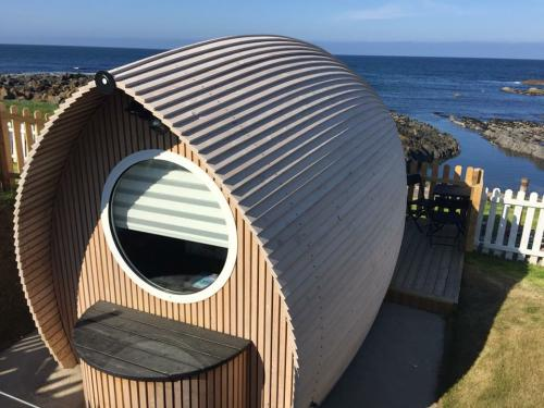Door to the shore is a luxurious Eco Pod crafted in the style of an upturned boat made from Larch Wood