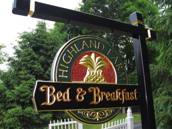 Highland Farm sign
