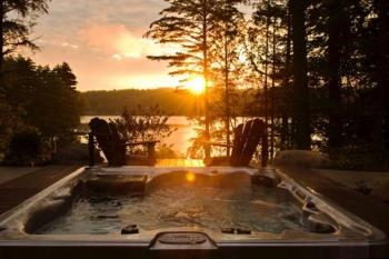 The year-round outdoor hot tub is a fantastic place to relax with your special someone!