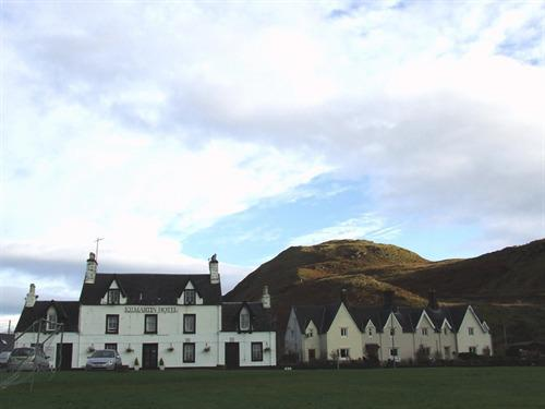 View of the Hotel from the Village Green, with the Kilmartin Hill behind