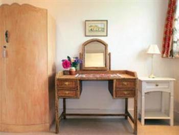 The Gothic Room has a charming private dressing room with ample storage space.