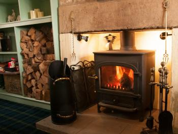 The Snug with a Real Wood Burner