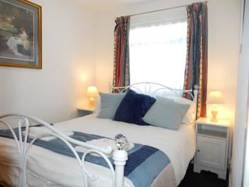 Dartmouth Chalet Holidays - Happy Days. Bedroom 1.1 double bed..