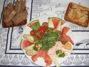 A light supper of smoked salmon and prawns served with fresh rocket, water melon, humus and home made bread;  priced at £7.50