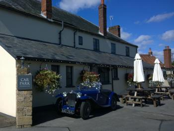Classic cars at the rear of The Helyar Arms