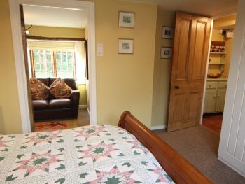 The Wheelwrights bedroom leading into the snug room
