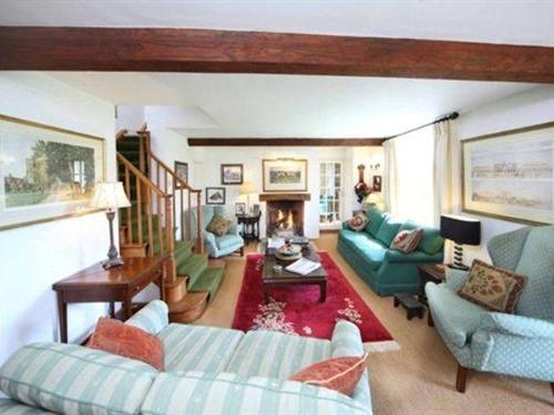 The charming sitting room has a log fire