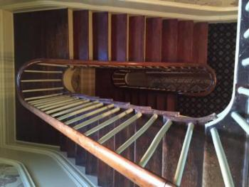 The three story staircase, original to the house, is an architectural gem.