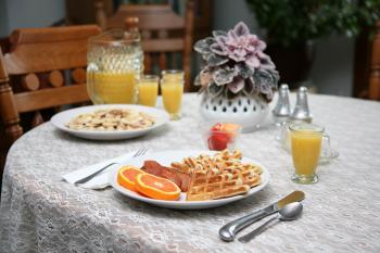 Homemade Buttermilk Waffles with Bacon ... one of our breakfast menu choices.