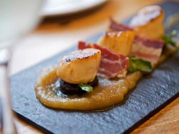 Seared Scottish king scallops, pancetta, apple puree with locally sourced black pudding.