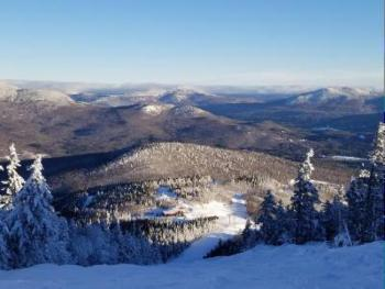 View from Sunday River traisl. this could be you as yu step out of your Brookside or Fall line condo for first trax. No parking car & lugging gear when you stay slopeside with us.