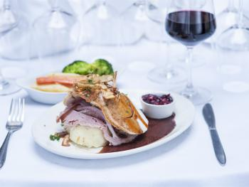 Our Restaurant menu : Roast Turkey and Ham with garden herb stuffing and cranberry compote