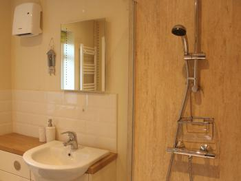 Bathroom with large walk-in shower, heated towel rail and underfloor heating