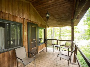Each cottage features a private porch with lake view