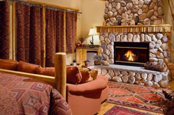 """""""Cedar"""" Guest room has a king-size bed, sitting area, fireplace, Jacuzzi, and large screened porch"""