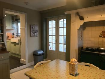 You are sure to be warm and comfortable in our kitchen diner.  The lovely antique farmhouse table seats up to 6 people, and is right alongside the Rayburn.