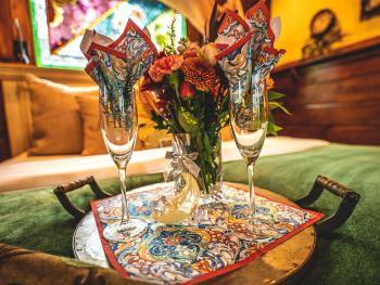 Order a Romance Tray with flowers from our local florist, custom HH champagne flutes, a bottle of champagne, and our signature star & moon chocolates.