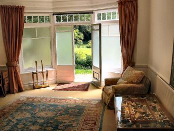The guest sitting room opens onto the gardens