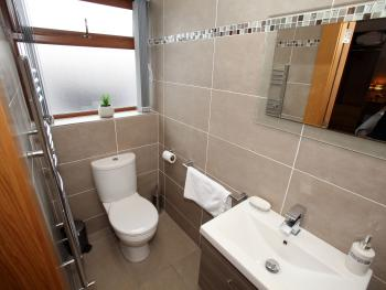 Fully tiled larger double room bathroom