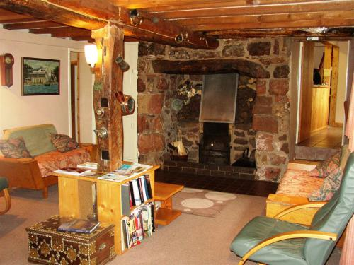 The Lounge with beams and inglenook fireplace