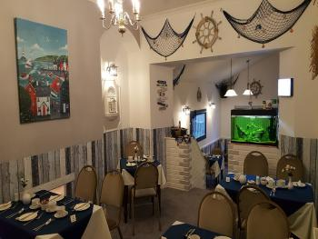 Our beach themed dining room will hopefully put a smile of your face